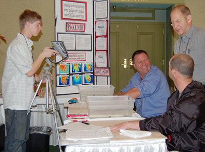 Shay Edwards, left, discusses his project with attendees at IR/Info 2008