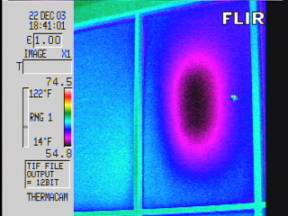 Thermogram shows thermal anomaly at center of insulated window. Pattern typical of failed IGU seal.