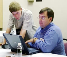 Shay Edwards, left, confers with Jim Seffrin, right at IR/INFO 2006.