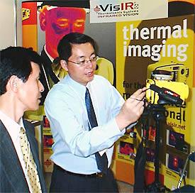 Regional Sales Manager, David Ge, demonstrating Thermoteknix' VisIR® Ti 200 infrared camera at InterMaintech Maintenance Tradeshow in Tokyo.